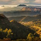 Mountain view with haze and evening light by Ralph Goldsmith