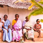 Sitting outside their hut, Kavanur, India by indiafrank