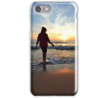 Woman watching the sunset over the sea iPhone Case/Skin