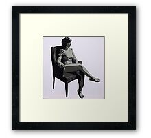 chair at the window Framed Print