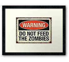 Do not feed the zombies Framed Print