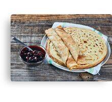 Pancakes filled with dark cherry jam Canvas Print