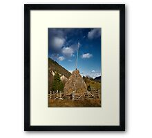 Hay stacks and mountains Framed Print