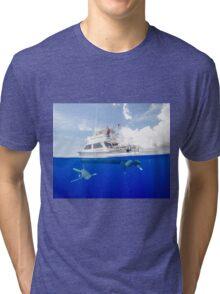 Oceanic White Tips Sharks Cruising Under A Boat Tri-blend T-Shirt