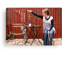 Cat and owner playing Canvas Print