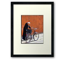 A Priest And His Bicycle. Framed Print