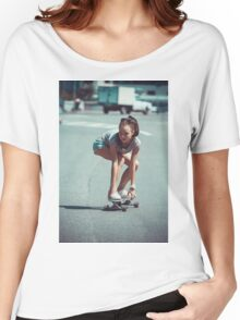 Young woman making downhill with a skateboard Women's Relaxed Fit T-Shirt