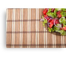 Fragment of a transparent plate of fresh vegetarian salad of raw vegetables Canvas Print
