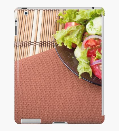Plate with fresh salad of raw tomatoes and lettuce iPad Case/Skin