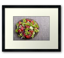 Top view on a plate with fresh salad of raw vegetables Framed Print