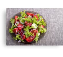 Top view on a plate with fresh salad of raw vegetables Canvas Print