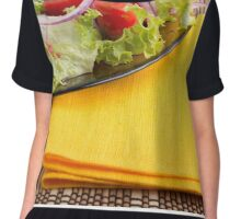 Fragment of a transparent plate closeup with fresh vegetable salad Chiffon Top