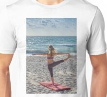 Woman play yoga on the sea Unisex T-Shirt