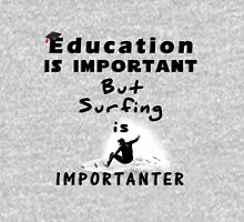 Surfing is importanter Unisex T-Shirt