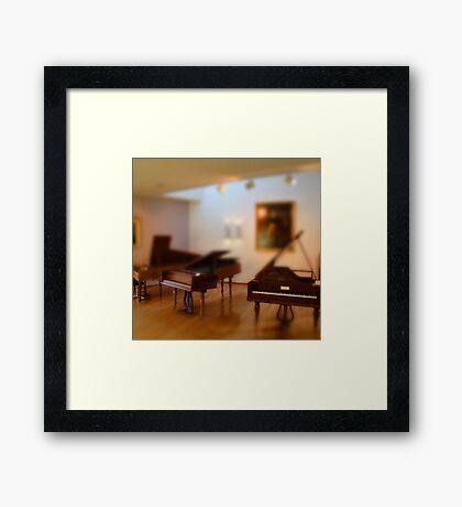 tiny pianos Framed Print
