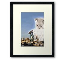 cat plays with gherkin Framed Print