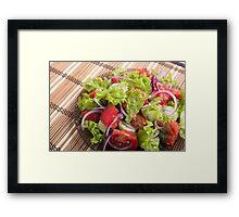 Fragment of vegetarian salad from fresh vegetables closeup Framed Print