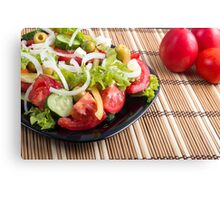 Closeup view fresh natural salad with raw tomato, cucumber, olives Canvas Print