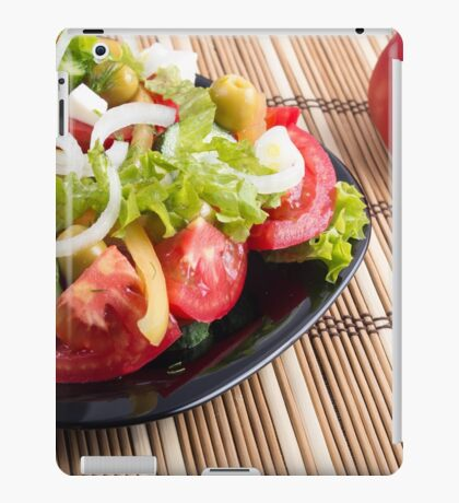 Closeup view fresh natural salad with raw tomato, cucumber, olives iPad Case/Skin