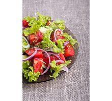 Fragment of a transparent plate with a fresh salad of raw vegetables Photographic Print