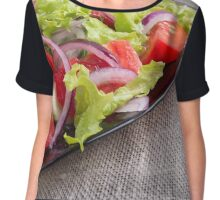 Side view on a diagonal on a plate with fresh salad of raw vegetables closeup Chiffon Top