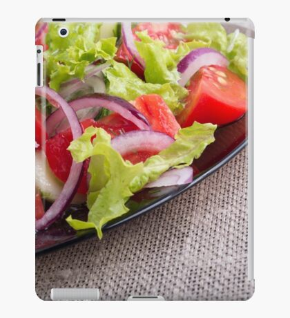 Side view on a diagonal on a plate with fresh salad of raw vegetables closeup iPad Case/Skin