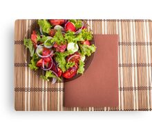 View from above on a plate with fresh salad of raw tomatoes Canvas Print