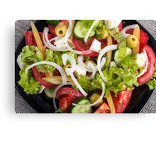 Top view of a plate of salad made from natural raw vegetables Canvas Print