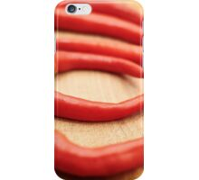 Red hot chili peppers on wooden board iPhone Case/Skin