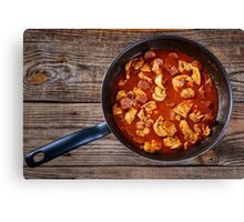Chicken meat and chorizo cooking in the frying pan Canvas Print