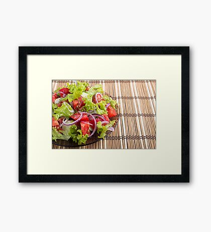 Plate with vegetarian salad with fresh tomatoes, onion and lettuce Framed Print