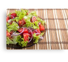 Plate with vegetarian salad with fresh tomatoes, onion and lettuce Canvas Print