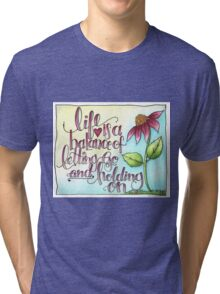 Life Is A Balance of Letting Go and Holding On. -Rumi Tri-blend T-Shirt