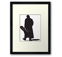 man walking with his guitar silhouette Framed Print