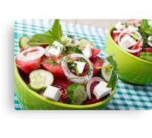 Useful vegetarian salad with raw tomatoes, cucumbers and onions Canvas Print