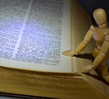 Small Wooden Manikin Using A Dictionary by Schoolhouse62