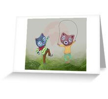 Arctic foxes at play in Lava Fields Greeting Card