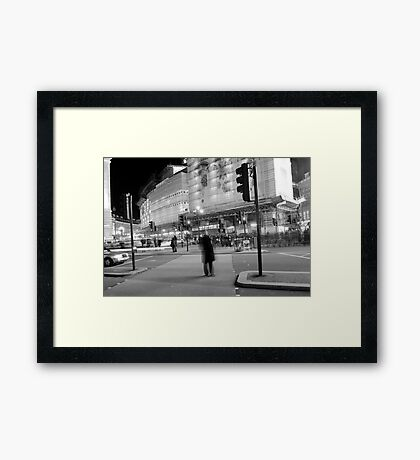 Central London in motion at night Framed Print