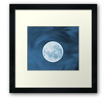 Magic Moon on a blue watercolored background Framed Print