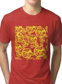 seamless background of cut across a lot of citrus fruits on white. Tri-blend T-Shirt