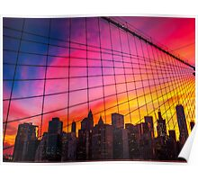 New York City Skyline at sunset with red purple and orange skies and the lines of the cables of the Brooklyn Bridge Poster