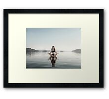 Young woman meditating on platform in the water art photo print Framed Print