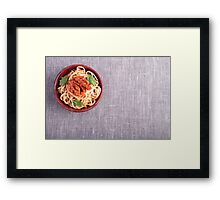 Top view of a gray mat with a small portion of cooked spaghetti  Framed Print