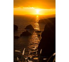 sunset over the coastal rocks with wild highl Photographic Print