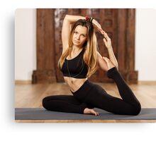 Woman yoga trainer in asana Canvas Print
