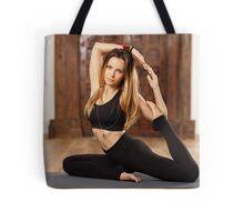 Woman yoga trainer in asana Tote Bag