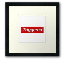 Triggered supreme Framed Print