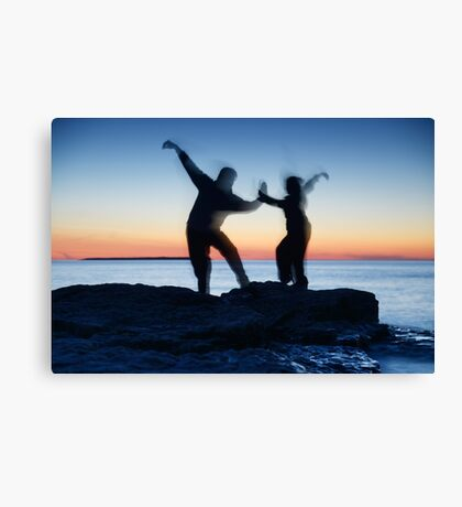 Blurred silhouettes of people practicing martial arts art photo print Canvas Print