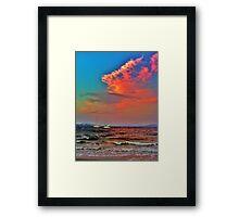 Raging ocean under a colourful sky Framed Print