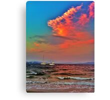Raging ocean under a colourful sky Canvas Print